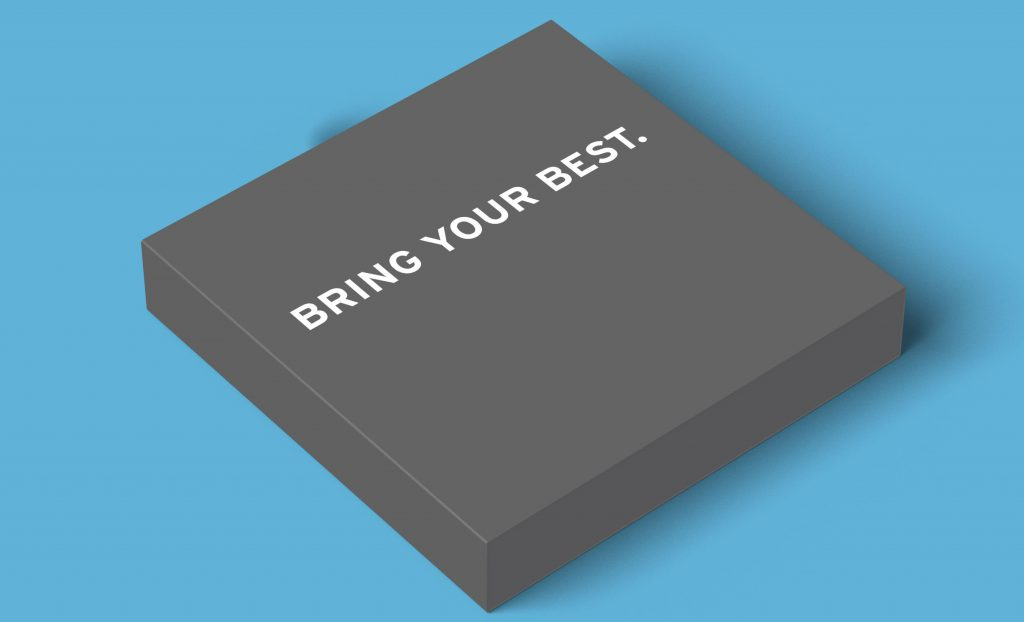 Dark grey Delta Police Department square box with white words reading 'bring your best' on the top, against Indalma Creative blue brand background colour
